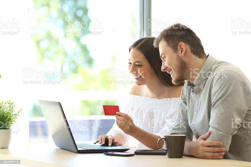 Buyers buying online with credit card stock photo