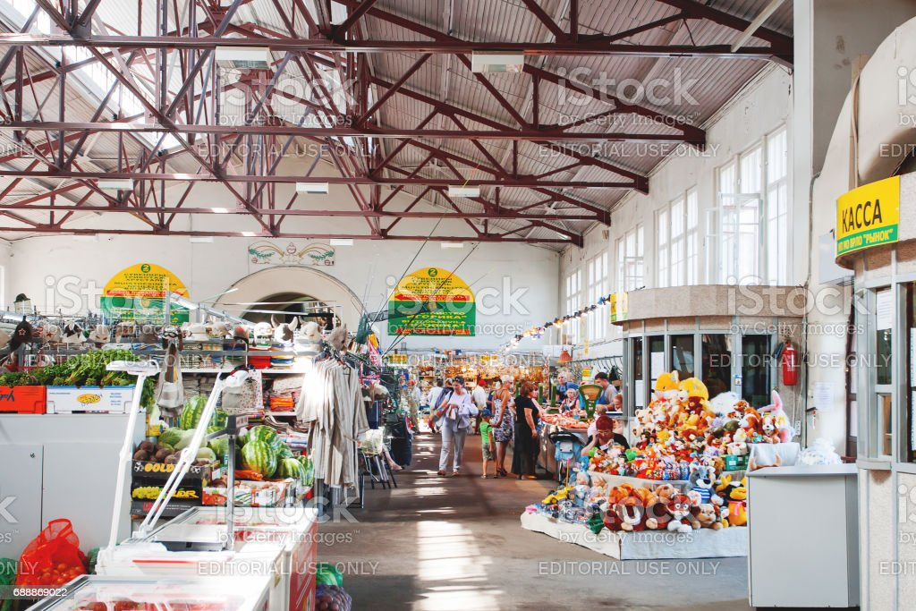 Buyers in old market. Stalls with vegetables, fruits, toys and souvenirs. Vyborg, Russia. stock photo