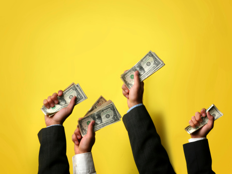 Buyers Offering Their Cash Stock Photo - Download Image Now