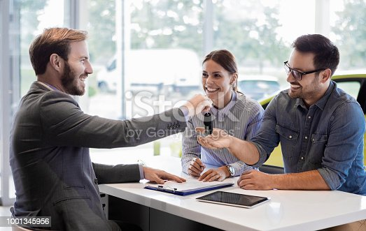 988321834 istock photo Buying a car in auto salon 1001345956