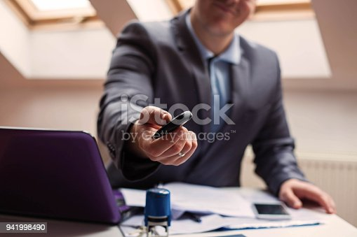 1138561232 istock photo Buying a car. 941998490