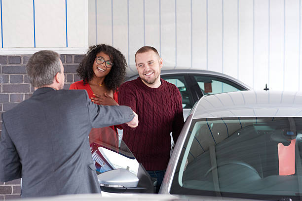 buying a second hand car - used car selling stock pictures, royalty-free photos & images