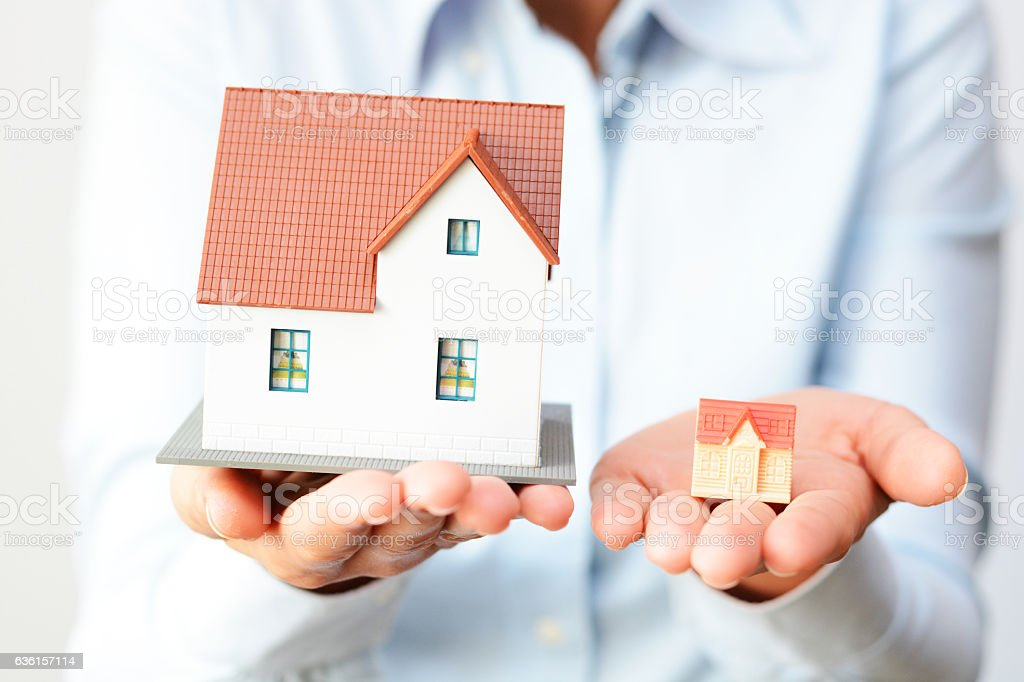 Buying a small or a big house considering prices  difference stock photo