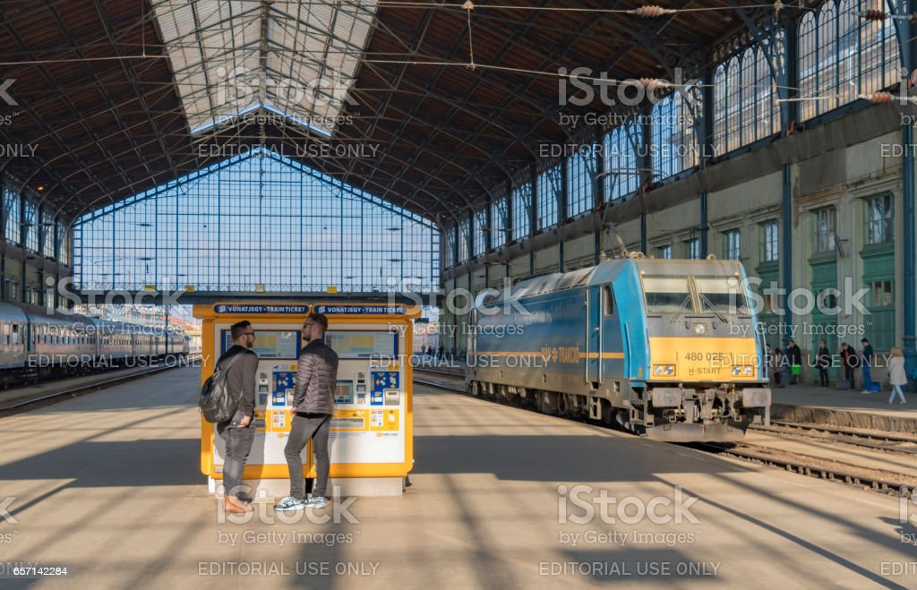 Buying a ticket at the train station in Budapest stock photo
