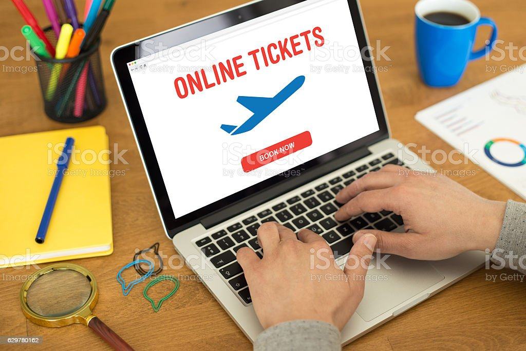 Buying airline tickets on computer stock photo