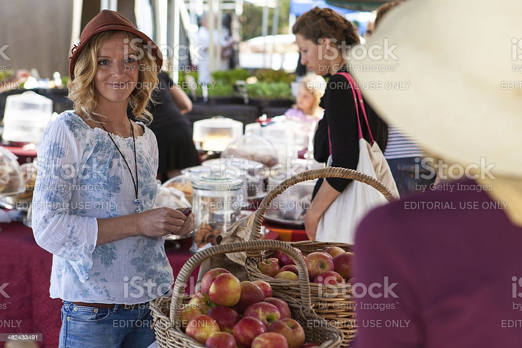 Buying apples at farmer's market stock photo