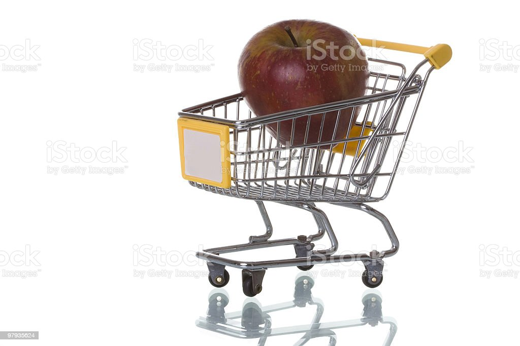 Buying apples at the supermarket royalty-free stock photo