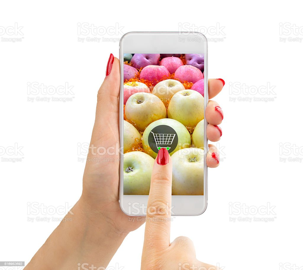 buying apples with phone stock photo