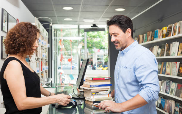 Buying books at a book store stock photo