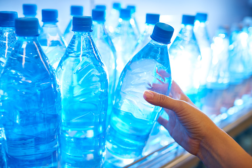 Buying Bottle Of Water Stock Photo - Download Image Now