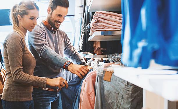 buying clothes at a mall. - herren outfit stock-fotos und bilder