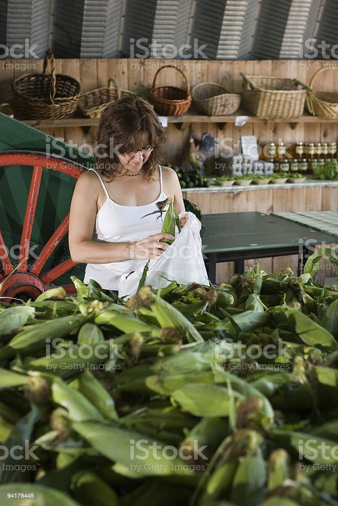 Buying corn at the farmer's market stock photo
