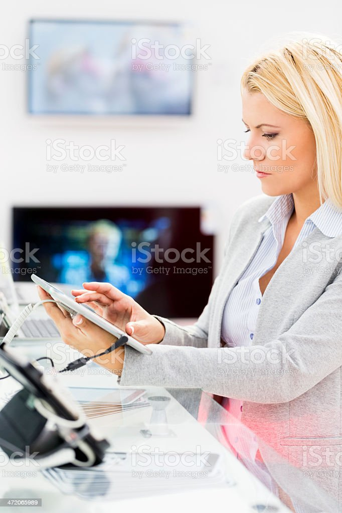 Buying digital tablet royalty-free stock photo