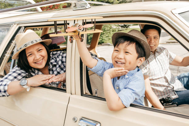buying family car - asian travel in car stock photos and pictures