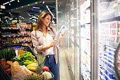 istock Buying food in grocery store. 1270924947
