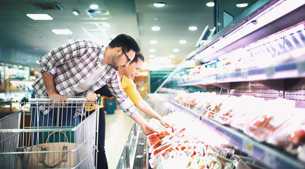 buying food in supermarket - meat stock photos and pictures