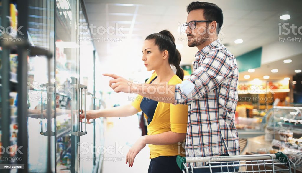 Buying food in supermarket stock photo