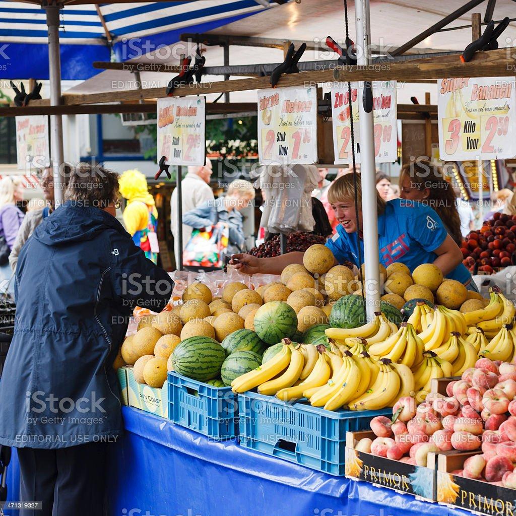 Buying fruit at the market royalty-free stock photo