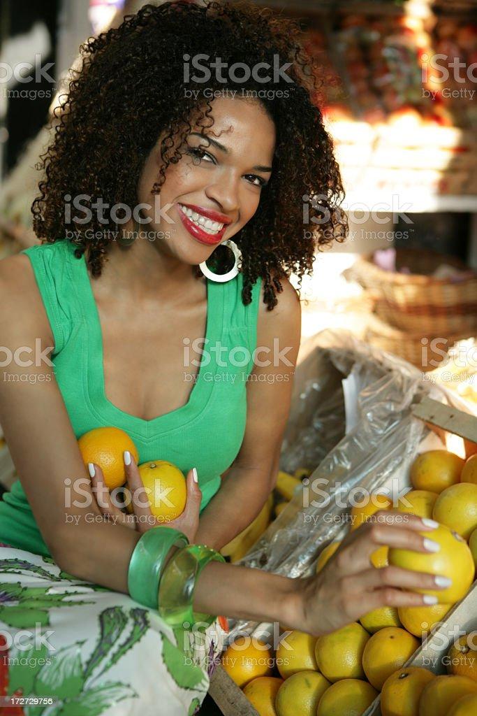 buying fruits on market royalty-free stock photo