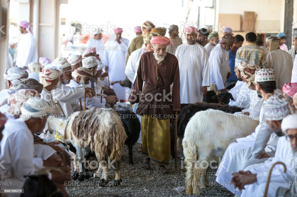 buying goats at a market stock photo