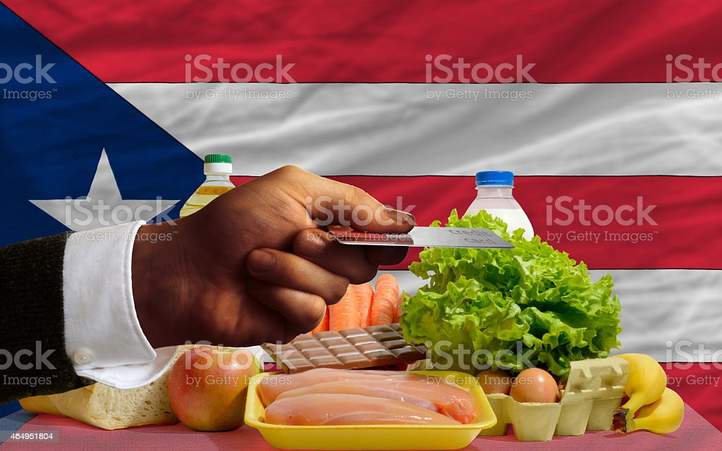 buying groceries with credit card in puerto rico stock photo