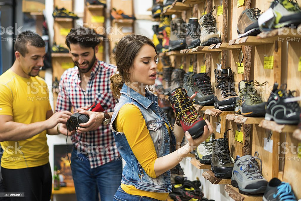 Buying hiking boots stock photo