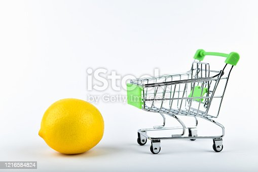 511190632 istock photo buying lemons. trading concept. Online shopping concept. Cart and lemons over a white background. business concept. Healthy eating concept 1216584824