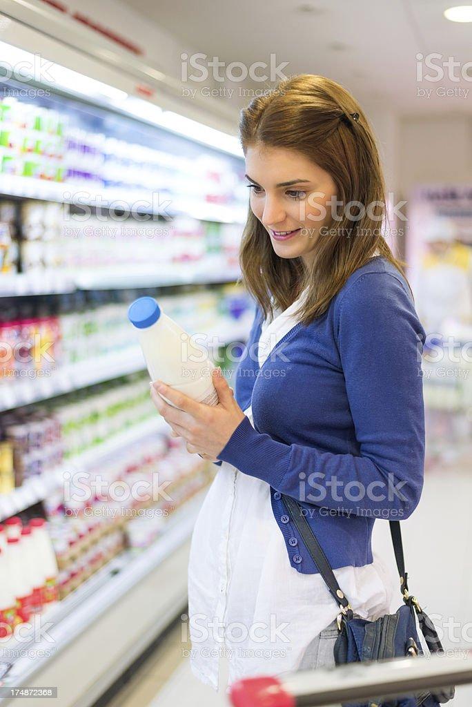 Buying milk royalty-free stock photo