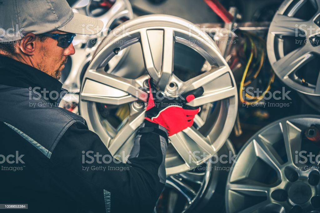 Buying New Alloy Wheels stock photo