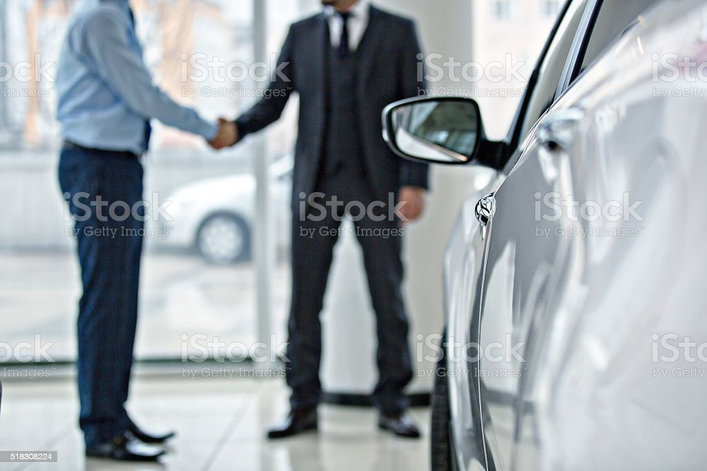 Buying new car at car showroom stock photo