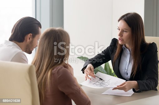 istock Buying new house concept, real estate agent consulting young couple 689401638