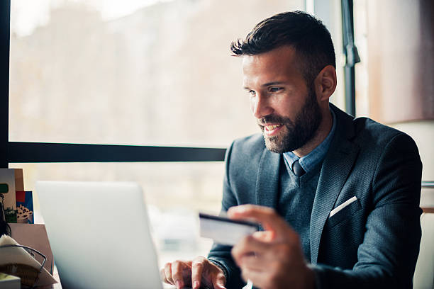 buying on the internet - business credit card stock photos and pictures