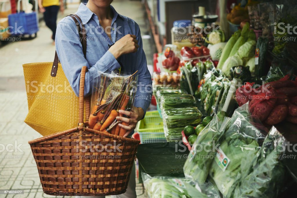 Buying organic vegetables stock photo