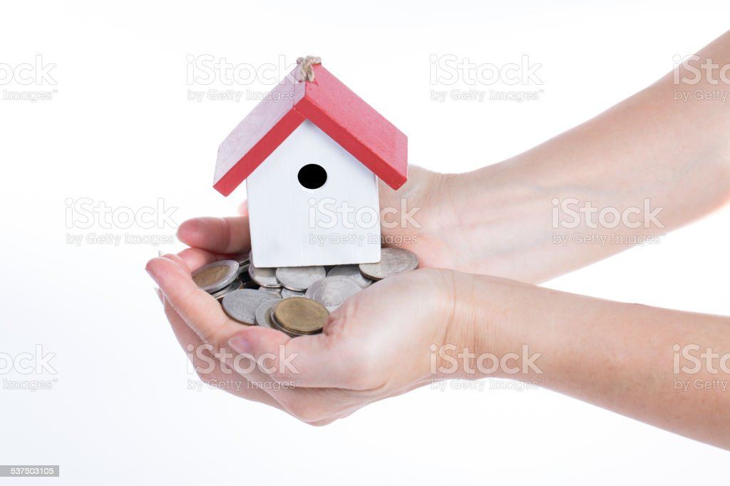 Buying property concept with giving money stock photo