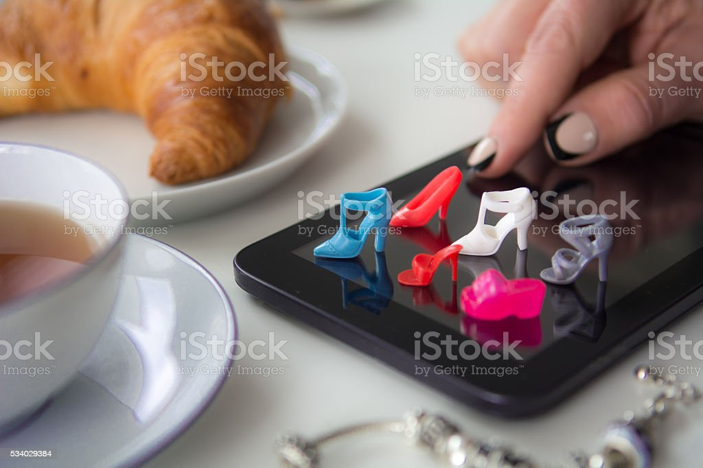 Buying shoes online stock photo