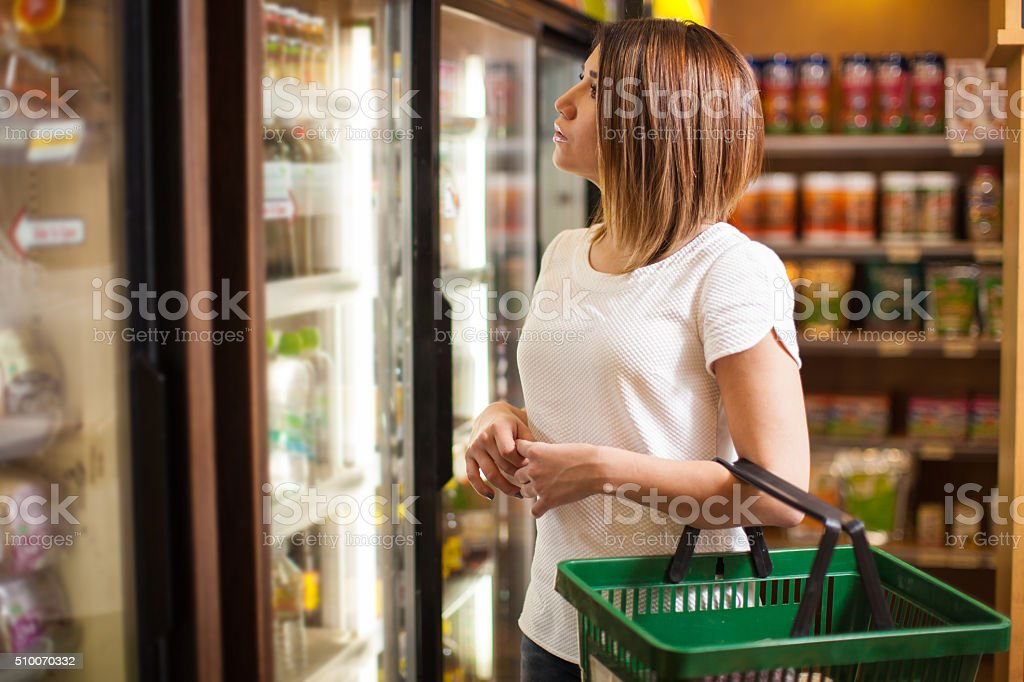 Buying some cold drinks at a grocery store stock photo
