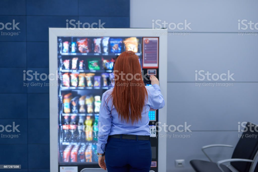 buying something in the airport stock photo