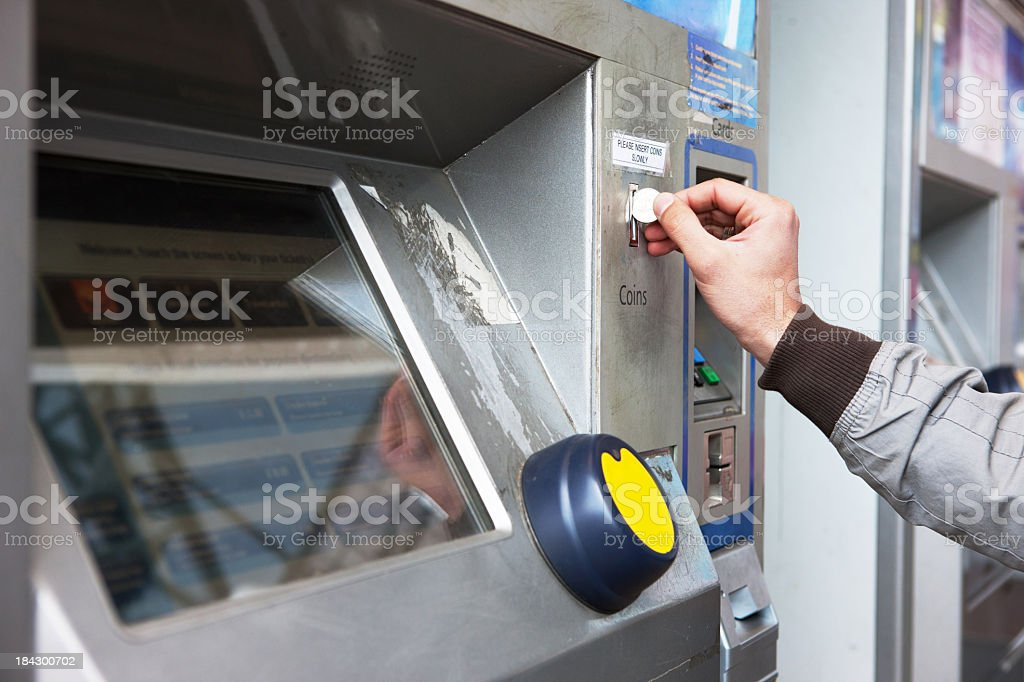 Buying ticket from an automated machine stock photo