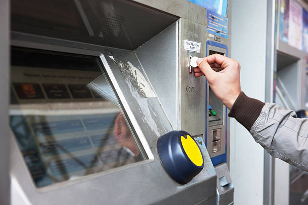 Buying ticket from an automated machine Buying ticket from an automated machine train ticket stock pictures, royalty-free photos & images