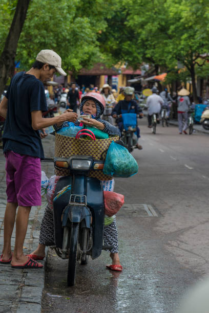 buying vegetables - motociclista стоковые фото и изображения