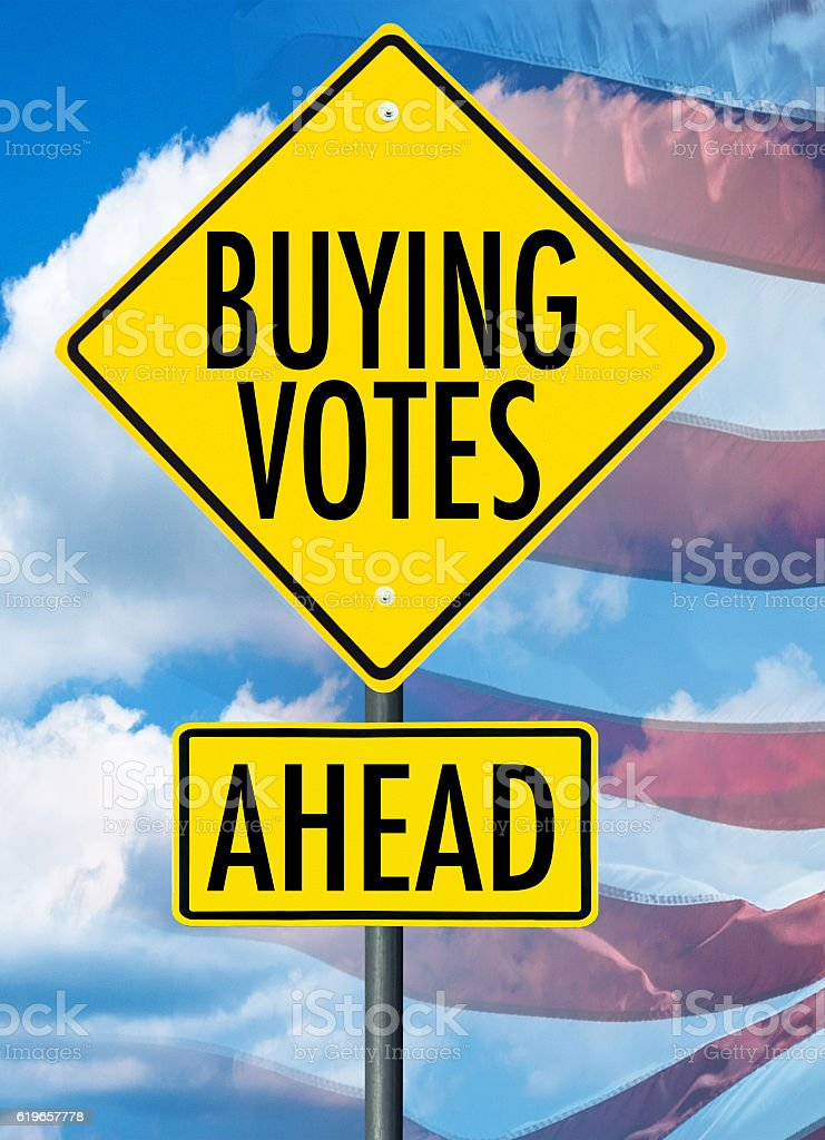 buying votes street sign stock photo