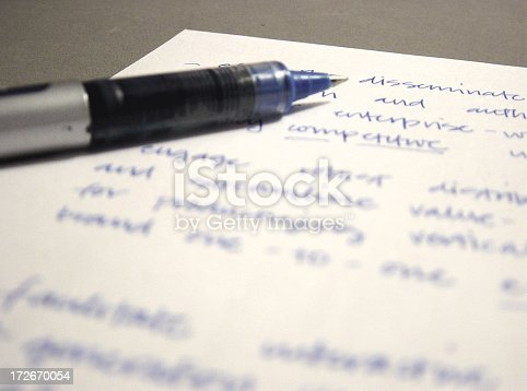 pen over paper with business-related notes.