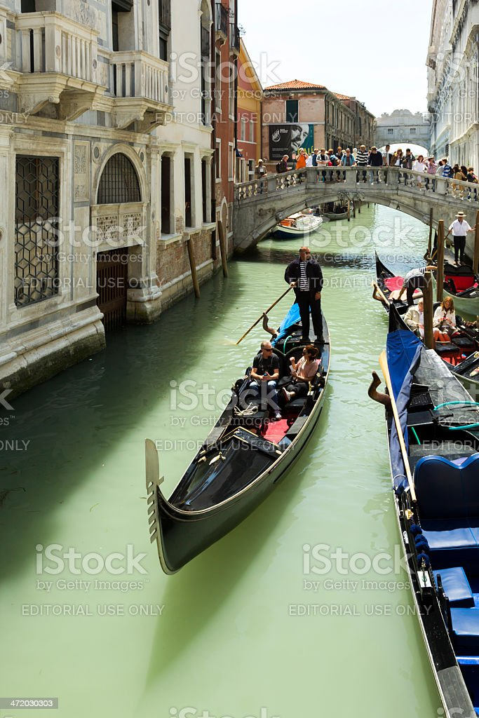 By numerous tourists taking pictures of the gondolier royalty-free stock photo