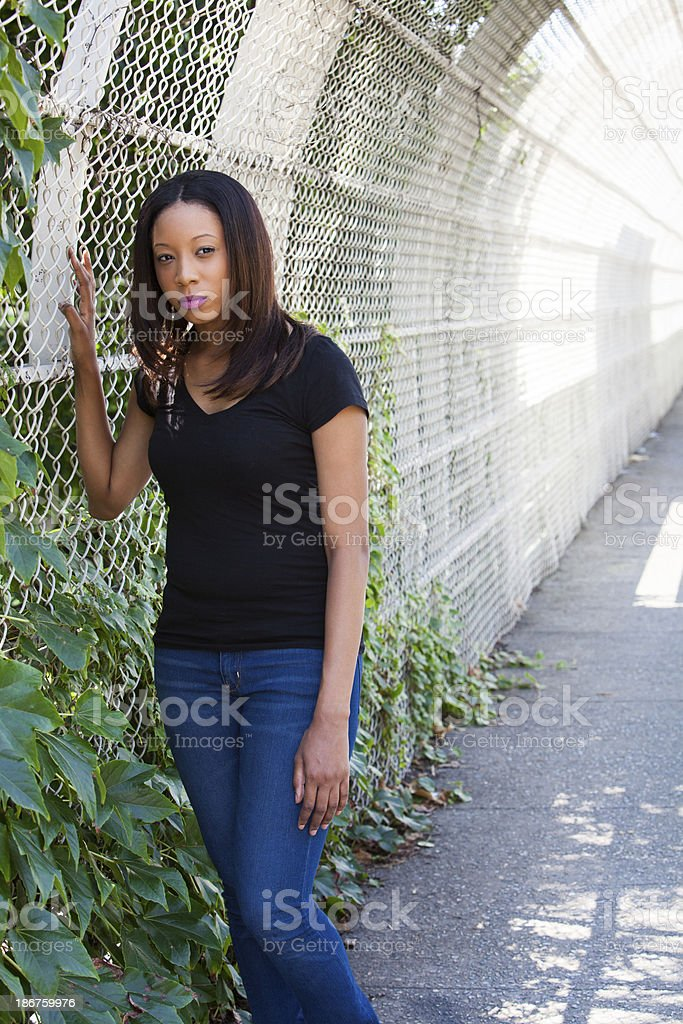 By the fence royalty-free stock photo