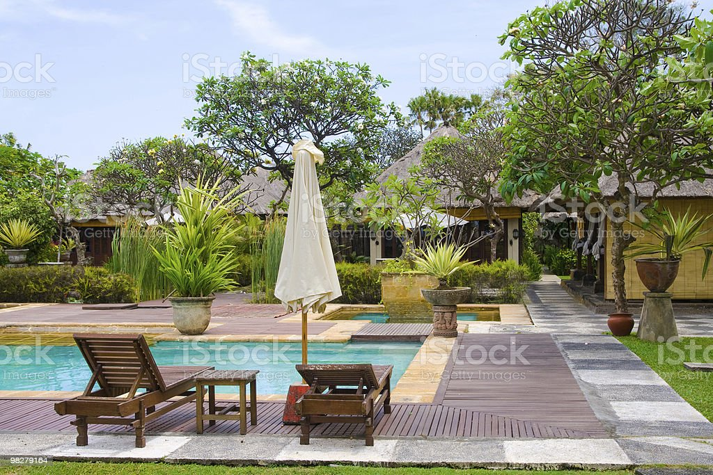 By the swimming pool royalty-free stock photo