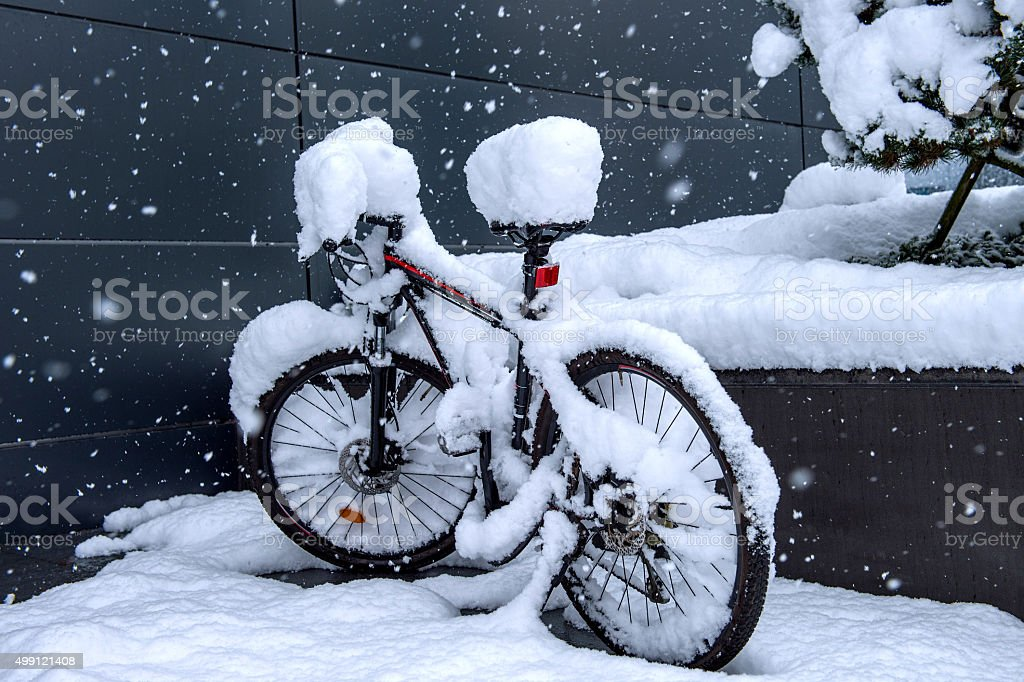 Bycicle covered by snow. stock photo