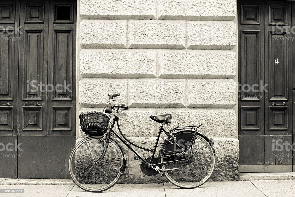 Bycicle Leaning on the Wall in Rome, Black and White royalty-free stock photo