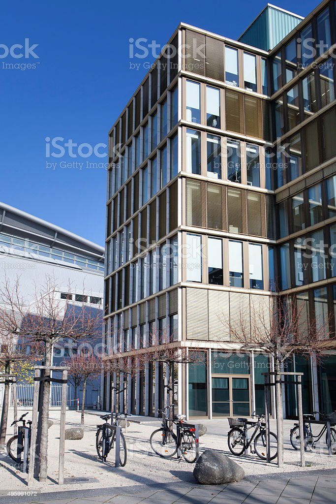 Bycicles in front of an office buildings facade stock photo