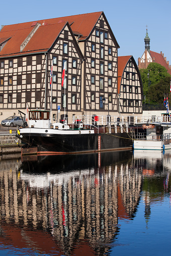 Granaries in the city of Bydgoszcz with reflection in Brda river, Poland.