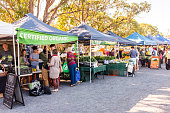 Byron Bay, Australia - September 17, 2014:  Various stalls selling goods at Byron Bay Farmers Market, Byron Bay, New South Wales, Australia